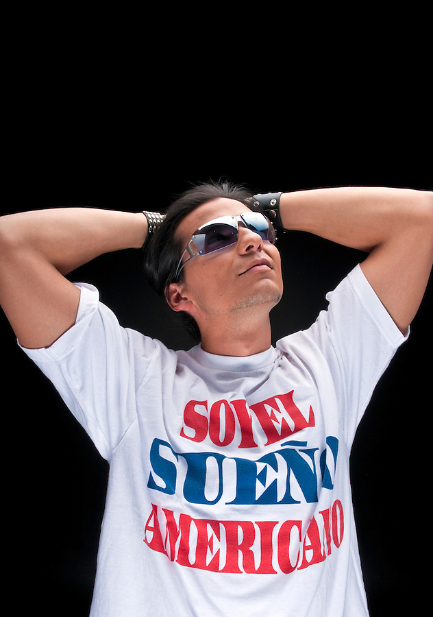 "Young hispanic immigrant enjoys the realization of his american dream. T-Shirt with inscription in spanish ""I am the american dream"" Space for copy in top."