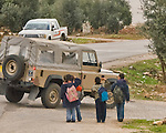 Jordan - Small children frequently come to attention and salute -- showing huge smiles -- whenever they see a military vehicle.  © Rick Collier