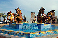 Dubai, United Arab Emirates. Al Qasr Hotel.  Fountain in front of the main entrance to the hotel..