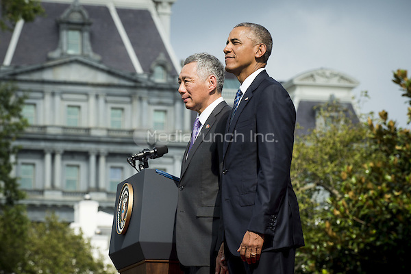 United States President Barack Obama and Prime Minister Lee Hsien Loong of Singapore during official welcoming ceremonies on the South Lawn of the White House in Washington, DC on August 2, 2016. Lee is on a State Visit to the United States.   <br /> Credit: Pete Marovich / Pool via CNP/MediaPunch