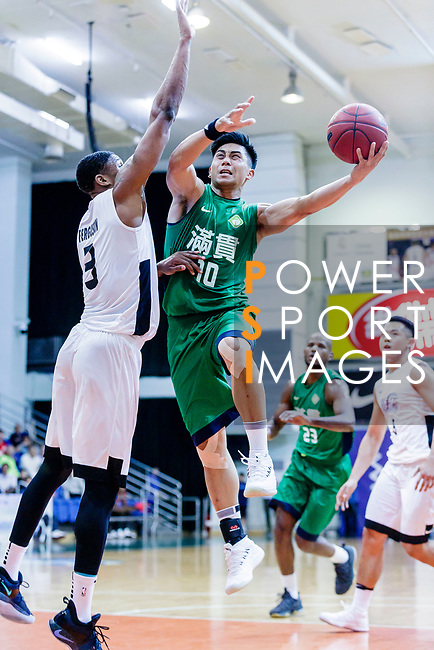 Cheung Wai Hong #10 of Tycoon Basketball Team goes to the basket against the HKPA during the Hong Kong Basketball League game between HKPA and Tycoon at Southorn Stadium on June 22, 2018 in Hong Kong. Photo by Yu Chun Christopher Wong / Power Sport Images