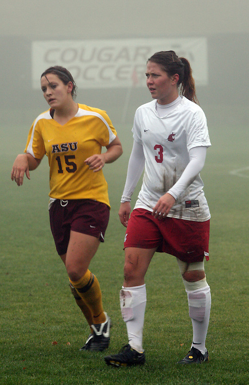 Kiersten Dallstream (#3), Washington State Cougar junior forward, watches play at the other end of the foggy Lower Soccer Field as the Cougars went in to double overtime during their match with the Arizona State Sun Devils in Pullman, Washington, on November 9, 2008.  The Cougars needed a victory for a chance at an NCAA bid and they finally prevailed, 1-0, on a dramatic goal by Elysse Van Leer in the second overtime.