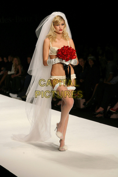 MODEL.Mercedes-Benz Fall 2006 L.A. Fashion Week - Agent Provocateur held at Smashbox Studios, Culver City, California, USA.Macrh 20th, 2006.Photo: Zach Lipp/AdMedia/Capital Pictures.Ref: ZL/ADM.runway catwalk model full length lingerie white.www.capitalpictures.com.sales@capitalpictures.com.© Capital Pictures.