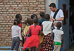 Father Francis Alvarez, SJ, from the Philippines, visits with children after Catholic Mass in Bunj, the host community for the Doro Refugee Camp in Maban County, South Sudan. Doro is one of four camps in Maban that together shelter more than 130,000 refugees from the Blue Nile region of Sudan. Jesuit Refugee Service provides educational and psycho-social services to both refugees and the host community.<br /> <br /> Misean Cara supports the work of JRS in the Maban camps and host community.