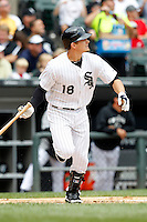 Chicago White Sox first baseman Brett Lillibridge #18 hits a home run in the first inning during a game against the Kansas City Royals at U.S. Cellular Field on August 14, 2011 in Chicago, Illinois.  Chicago defeated Kansas City 6-2.  (Mike Janes/Four Seam Images)