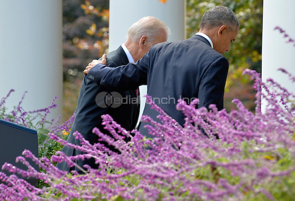 United States President Barack Obama (R) puts his arm around Vice President Joe Biden after making remarks on Republican President-elect Donald J. Trump's presidential victory over Former Secretary of State Hillary Clinton, at the White House, November 9, 2016, in Washington, DC. Obama invited Trump to visit the White House and promised a smooth transition.   <br /> Credit: Mike Theiler / Pool via CNP /MediaPunch