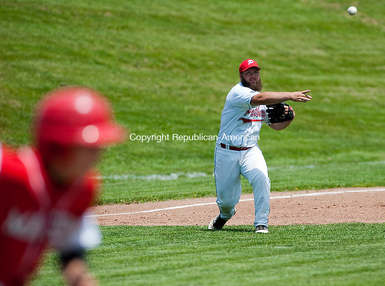 SOUTHBURY, CT-052614JS15--Pomperaug's Jake Parsell (36) throws out a runner after fielding a ground ball during their SWC tournament game against Masuk Monday at Pomperaug High School in Southbury. <br /> Jim Shannon Republican-American