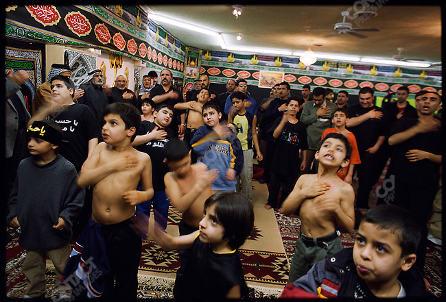 Shiite attend the Iraqi-American Karbala Mosque on Ashura, the mourning day for Imam Hussien. Many of those in attendance supported war in Iraq at that time; they belonged to a group harshly repressed by Saddam Hussein. Dearborn, Michigan, USA, March 2003