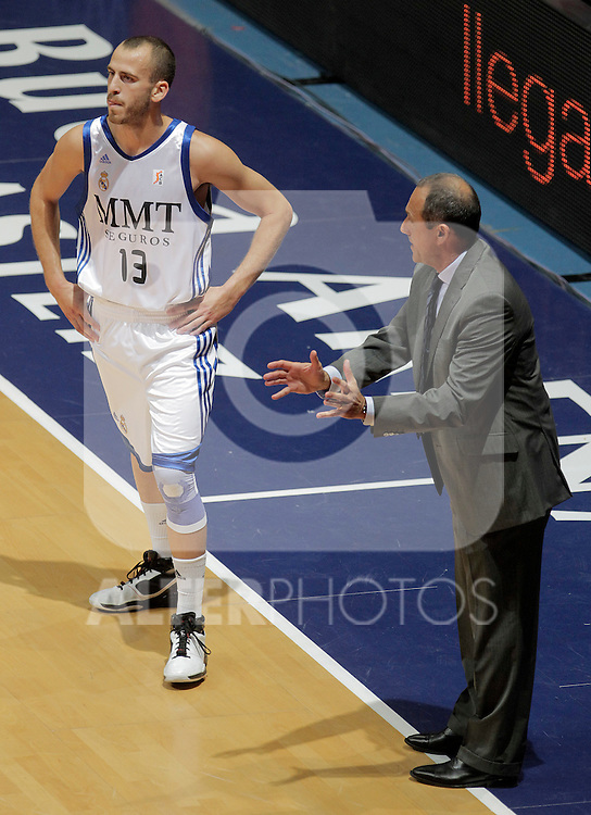 Real Madrid's Sergio LLull (l) and the coach Ettore Messina during ACB Supercup Semifinal match.September 24,2010. (ALTERPHOTOS/Acero)