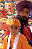 """Rome April 30 2006  .Piazza Vittorio  .Sikh """"Punj Pyare"""" (Five Beloved Ones) lead a religious parade.The parade is for Visaki, a traditional Sikh celebration..Father and child Sikh  ."""