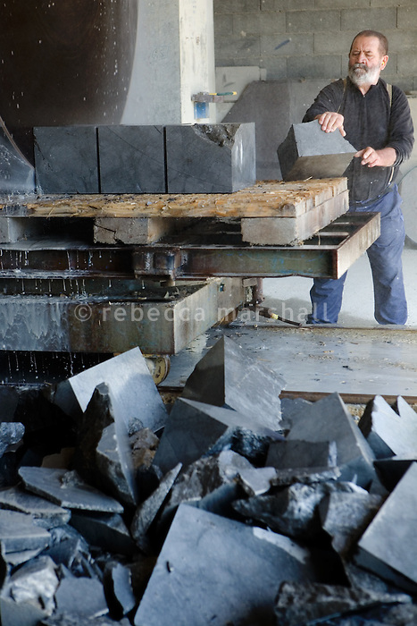 Pierre Gavazzi, stonemason (tailleur de pierre) at work in his workshop at Annot quarry, Annot, France, 26 April 2010