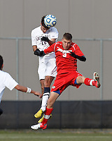 University of Connecticut midfielder Colin Bradley (20) and University of New Mexico midfielder Nik Robson (3) battle for head ball. .NCAA Tournament. With a goal in the second overtime, University of Connecticut (white) defeated University of New Mexico (red), 2-1, at Morrone Stadium at University of Connecticut on November 25, 2012.