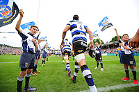 Luke Charteris and the rest of the Bath Rugby team run out onto the field. Aviva Premiership match, between Bath Rugby and Newcastle Falcons on September 10, 2016 at the Recreation Ground in Bath, England. Photo by: Patrick Khachfe / Onside Images