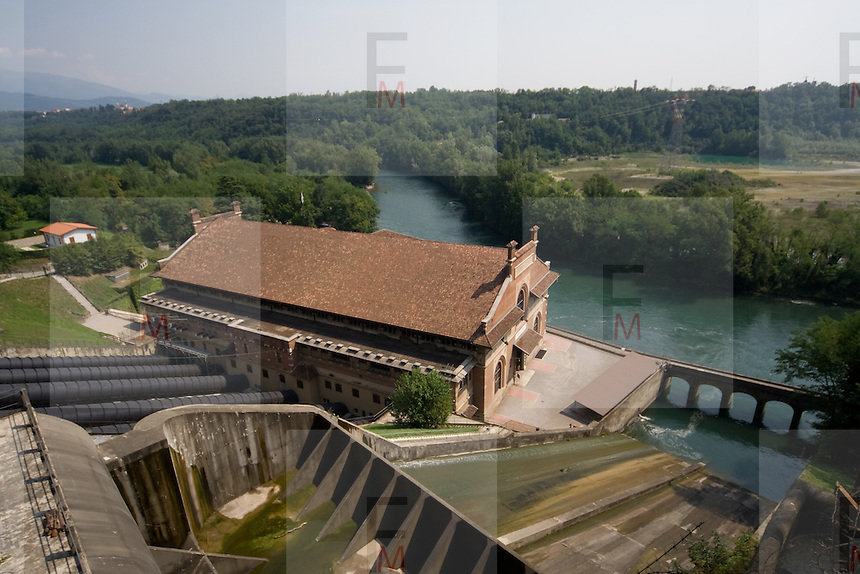 La centrale idroelettria in stile liberty Esterle, di proprietà della società Edison, lungo la pista ciclabile dell'Adda...Aerial viewing of Hydroelectric plant Esterle, over Adda river.