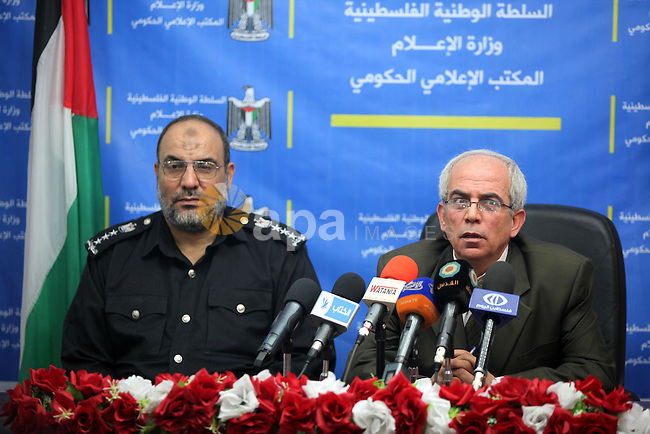 Palestinian director General of Civil Defense ( brigadier General) Yusuf al-Zahar and deputy Ministry of Local Government Yousef Allgrez deliver a speech during a press conference in Gaza city on Nov. 03, 2013. Photo by Mohammed Asad