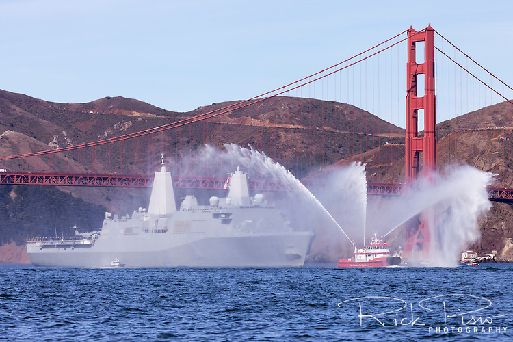 USS San Diego (LPD-22), a San Antonio-class Amphibious Transport Dock, is led into San Francisco Bay by San Francisco Fire Department Fireboat #3.
