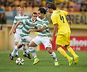 Celtic's Beram Kayal gets past Villarreal's Pina.