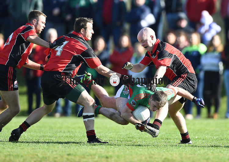 Colm Donnellan of Kilmurry Ibrickane  in action against Stephen Hayes and Sean Cooney of Meelick during their Junior A  county final at Gurteen. Photograph by John Kelly.