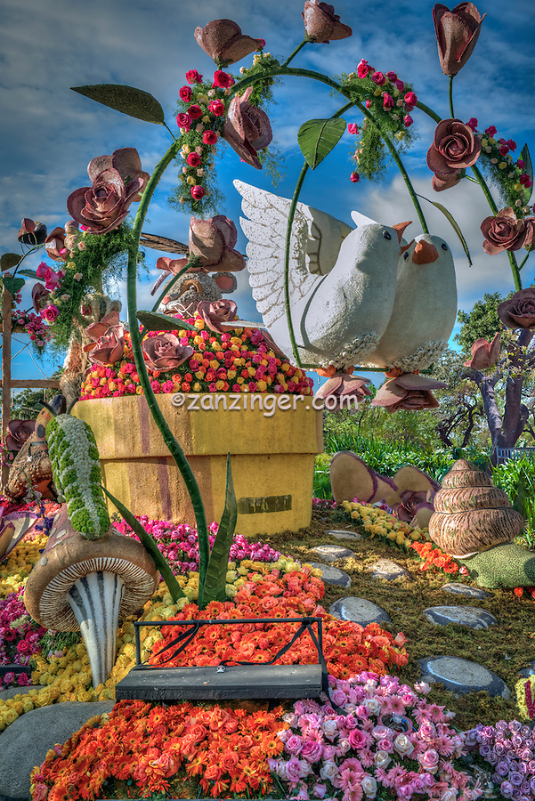 "Rotary Float  ""Working Together for Peace""  New Year's Day Tournament of Roses Parade, flower-decorated floats are required to be covered with plant material, living or dead. Visit http://david-zanzinger.artistwebsites.com/ for galleries"