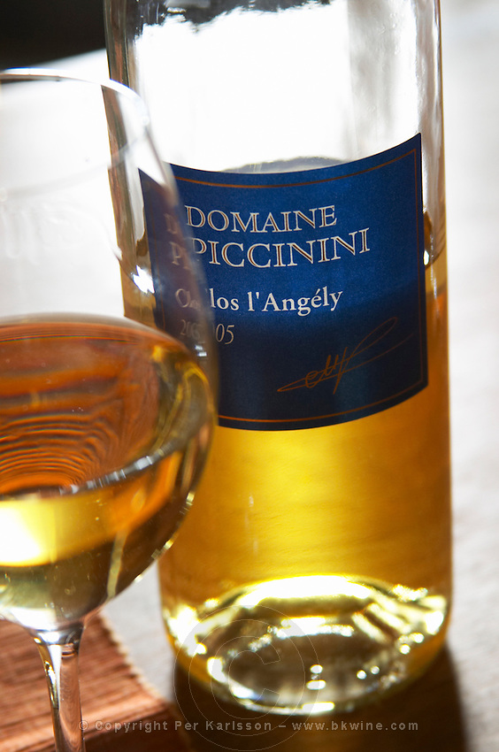 Clos l'Angely white. Domaine Piccinini in La Liviniere Minervois. Languedoc. France. Europe. Bottle. Wine glass.