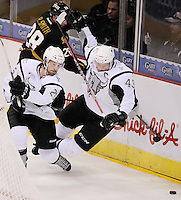San Antonio Rampage's Colby Robak, left, clears the puck as Texas Stars' Reilly Smith, rear, takes down Rampage's Nolan Yonkman during the third period of an AHL hockey game, Saturday, Oct. 13, 2012, in San Antonio. Texas won 2-1. (Darren Abate/pressphotointl.com)