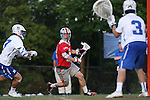 09 May 2015: Ohio State's David Planning (12) is watched by Duke's Danny Fowler (3) and Ben Scharf (7). The Duke University Blue Devils hosted the Ohio State University Buckeyes at Koskinen Stadium in Durham, North Carolina in a 2015 NCAA Division I Men's Lacrosse Tournament First Round match. Ohio State won the game 16-11.