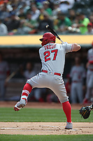 OAKLAND, CA - MARCH 28:  Mike Trout #27 of the Los Angeles Angels bats against the Oakland Athletics during the game at the Oakland Coliseum on Thursday, March 28, 2019 in Oakland, California. (Photo by Brad Mangin)