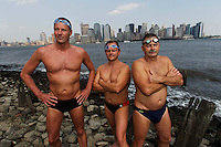 Swimmers compete in the annual 28.5 mile Manhattan Island Marathon swim, a full circumnavigation of Manhattan in New York City. Competitors brave the cold, crowded and polluted waters of the Hudson, East and Harlem rivers, guided through the treacherous currents by kayakers. Australians Steve Junk, Andrew Page and Selwyn Jelle pictured against the Manhattan skyline.