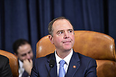 United States Representative Adam Schiff (Democrat of California), Chairman, US House Permanent Select Committee on Intelligence, waits to call the hearing to order after a break where Dr. Fiona Hill, former Senior Director for Europe and Russia, National Security Council (NSC), and David A. Holmes, Political Counselor, United States Embassy in Kyiv, Ukraine, on behalf of US Department of State, will continue their testimony during the US House Permanent Select Committee on Intelligence public hearing as they investigate the impeachment of US President Donald J. Trump on Capitol Hill in Washington, DC on Thursday, November 21, 2019.<br /> Credit: Ron Sachs / CNP<br /> (RESTRICTION: NO New York or New Jersey Newspapers or newspapers within a 75 mile radius of New York City)