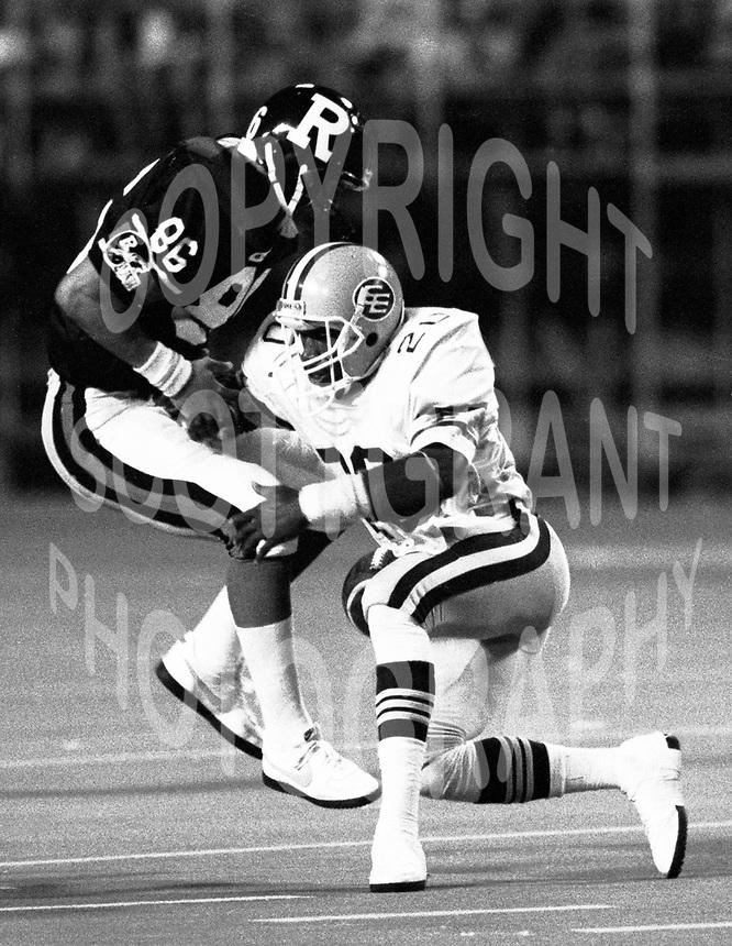 Don Wilson of the Edmonton Eskimos tackles Gerald Alphin Ottawa Rough Riders 1987. Photo Scott Grant