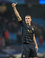 Jozo Simunovic of Celtic shows his appreciation to the support during the UEFA Champions League GROUP match between Manchester City and Celtic at the Etihad Stadium, Manchester, England on 6 December 2016. Photo by Andy Rowland.