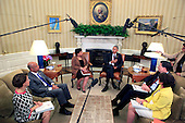 United States President Barack Obama meets with Attorney General Lynch and FBI Director Comey in the Oval Office of the White House in Washington, DC on  July 19, 2016   From left to right:  Cecilia Munoz, the Assistant to the President and Director of the Domestic Policy Council, Jeh Johnson, the Secretary of the Department of Homeland Security.Attorney General Lynch, President Obama, FBI Director Comey, Valerie B. Jarrett , Senior Advisor to President Barack Obama.  <br /> Credit: Dennis Brack / Pool via CNP