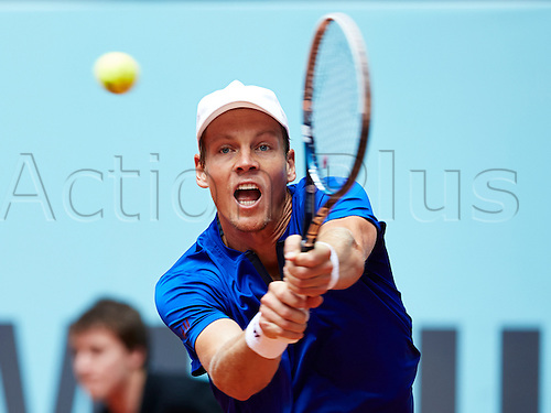 07.05.2014 Madrid, Spain. Tomas Berdych of Czech Republic plays a double handed backhand during the game with Kevin Anderson of RSA on day 4 of the Madrid Open from La Caja Magica.