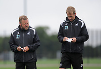 Swansea City assistant manager Billy Reid (L) and Swansea City manager Graham Potter (R) during the Swansea City Training Session at The Fairwood Training Ground, Wales, UK. Tuesday 14th August 2018