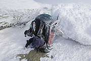 Appalachian Trail - Snow-covered backpack during extreme winter weather conditions on the summit of Mount Lafayette in the White Mountains, New Hampshire.