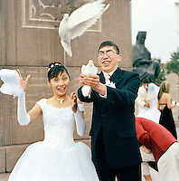 Bride and Groom releasing Doves, Almaty, Kazakhstan