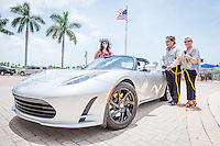 Eva Sugden Gomez with her son, Roman Gomez and his friend, Anastasia Tazmina, demos the spare power charger for her electric Tesla Roadster at Bayfront, Naples, Florida, USA, July 19, 2012. Photo by Debi Pittman Wilkey, CoastalLife.com.