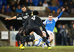 St Johnstone v Celtic.....19.02.13      SPL.Steven MacLean battles with Joe Ledley and Efe Ambrose.Picture by Graeme Hart..Copyright Perthshire Picture Agency.Tel: 01738 623350  Mobile: 07990 594431