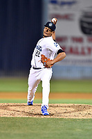 Asheville Tourists pitcher Julian Fernandez (22) delivers a pitch during a game against the Greensboro Grasshoppers at McCormick Field on April 28, 2017 in Asheville, North Carolina. The Grasshoppers defeated the Tourists 3-2. (Tony Farlow/Four Seam Images)