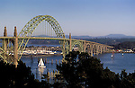 Historic Yaquina Bay Bridge with sailboat entering the harbor; Newport, Oregon coast..#2313-1916