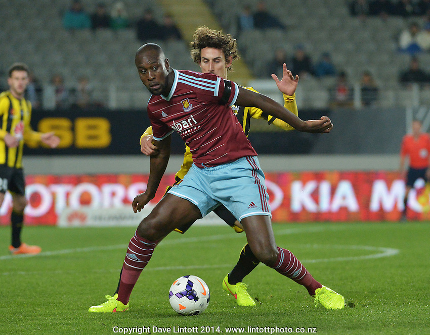 Carlton Cole holds off Alberto Riera during the Football United Tour match between Wellington Phoenix and West Ham United at Eden Park, Auckland, New Zealand on Wednesday, 23 July 2014. Photo: Dave Lintott / lintottphoto.co.nz