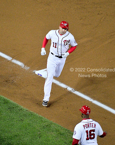 Washington Nationals third baseman Ryan Zimmerman (11) rounds third base after hitting a two-run home run in the first inning of game 5 of the NLDS against the St. Louis Cardinals at Nationals Park in Washington, D.C. on Friday, October 12, 2012.  The Cardinals won the game and the series 9 - 7..Credit: Ron Sachs / CNP