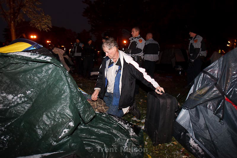 Trent Nelson  |  The Salt Lake Tribune.A man packs up his tent and belongs as Salt Lake City police cleared the Occupy Salt Lake tent city from Pioneer Park in Salt Lake City, Utah, Saturday, November 12, 2011.