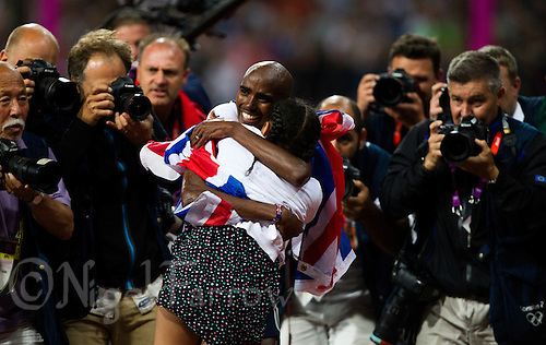 04 AUG 2012 - LONDON, GBR - Mo Farah (GBR) of Great Britain (centre) celebrates winning the men's 10000m final with his step daughter Rihanna during the London 2012 Olympic Games athletics at the Olympic Stadium in Stratford, London, Great Britain .(PHOTO (C) 2012 NIGEL FARROW)
