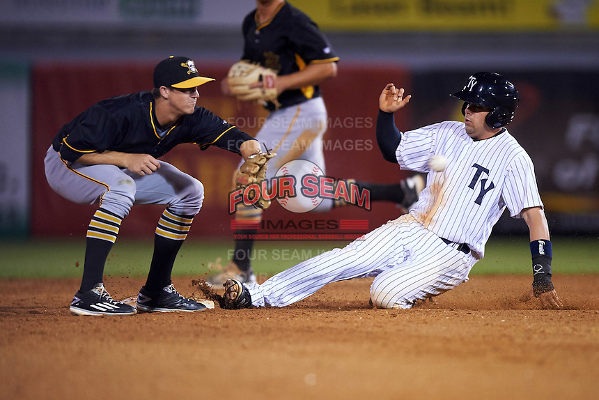 Tampa Yankees right fielder Michael O'Neill (12) slides into second as Kevin Newman (5) waits for a throw during a game against the Bradenton Marauders on April 11, 2016 at George M. Steinbrenner Field in Tampa, Florida.  Tampa defeated Bradenton 5-2.  (Mike Janes/Four Seam Images)