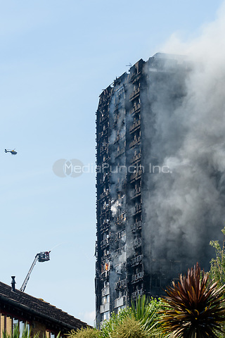 Portobello Road pedestrians watch the horror of the fire at Grenfell Tower in London's North Kensington which started last night.  London, England on June 14, 2017.<br /> CAP/CAM<br /> &copy;Andre Camara/Capital Pictures /MediaPunch ***NORTH AND SOUTH AMERICAS ONLY***