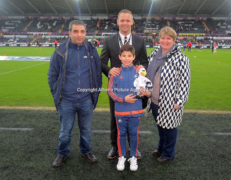 Swansea club ambassador Lee Trundle with academy youngster the Barclays Premier League match between Swansea City and Crystal Palace at the Liberty Stadium, Swansea on February 06 2016