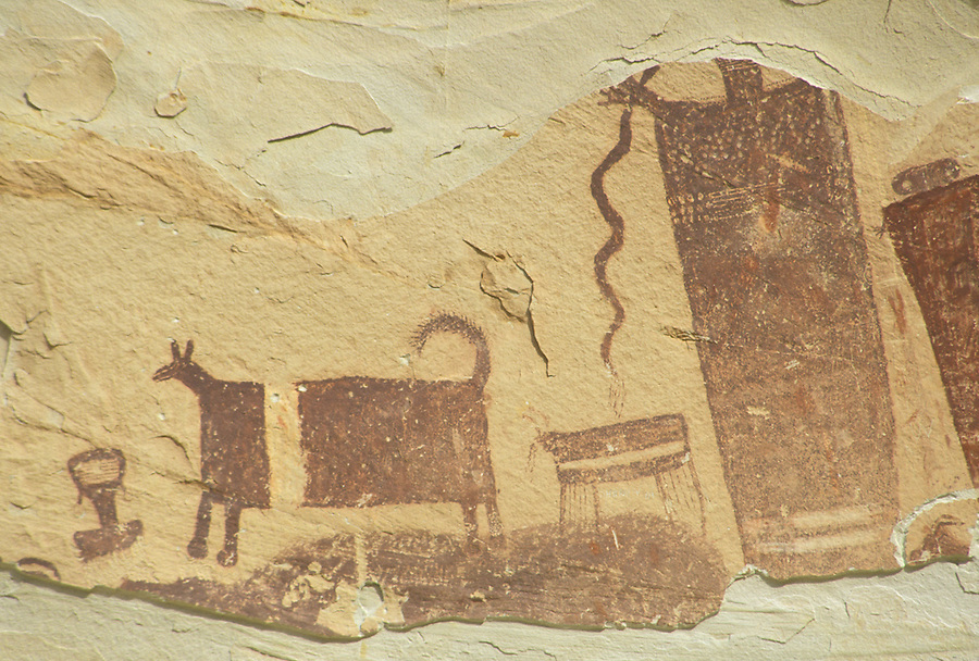 Pictograph of human figures and banded cow on canyon wall, Horseshoe Canyon Unit, Maze District, Canyonlands National Park, Utah