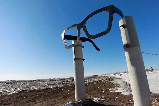 1/19/12 2:50:13 PM -- Clear Lake, IA, U.S.A. -- THIS IS FOR A LIFE COVER:.A giant pair of horn-rimmed glasses stand as a salute of Buddy Holly and mark the entrance to the crash site   a few miles outside of Clear Lake, Iowa..On Feb. 3, 1959, Buddy Holly, Ritchie Valens and the Big Bopper died when their plane crashed in a farm field north of Clear Lake, Iowa ? an event memorialized as ?the day the music died? in the 1971 song American Pie by Don McLean. The three 1950s stars played their last gigs at Clear Lake?s Surf Ballroom, which is intact today and holds an annual celebration of its moment in music history. The ballroom, largely the same as it was in its ?50s heyday, struggled as a for-profit business and has been operated as a non-profit since 2008. It hosts concerts, weddings, reunions and school tours. It has a small museum, but the big draw is the place itself. The maple dance floor and booths are original. One of the two original coat checks is still there and so is the phone that Holly used to call his wife before the fatal crash, the website boasts. The fun part is the annual gathering of fans from all over the world, which this year is Feb. 1-4 and is delicately called the ?winter dance party.? There are concerts each night, a bus outing to the crash site, which is marked by a giant pair of the glasses Holly wore, dance lessons, video and art contests and a gathering of the British Buddy Holly Society (whose members have been coming to Clear Lake for 23 years). Chuck Berry is a featured performer this year. It?s a charming and weird slice of Iowa life and rock ?n? roll history. -- ...Photo by Christopher Gannon for USA TODAY.