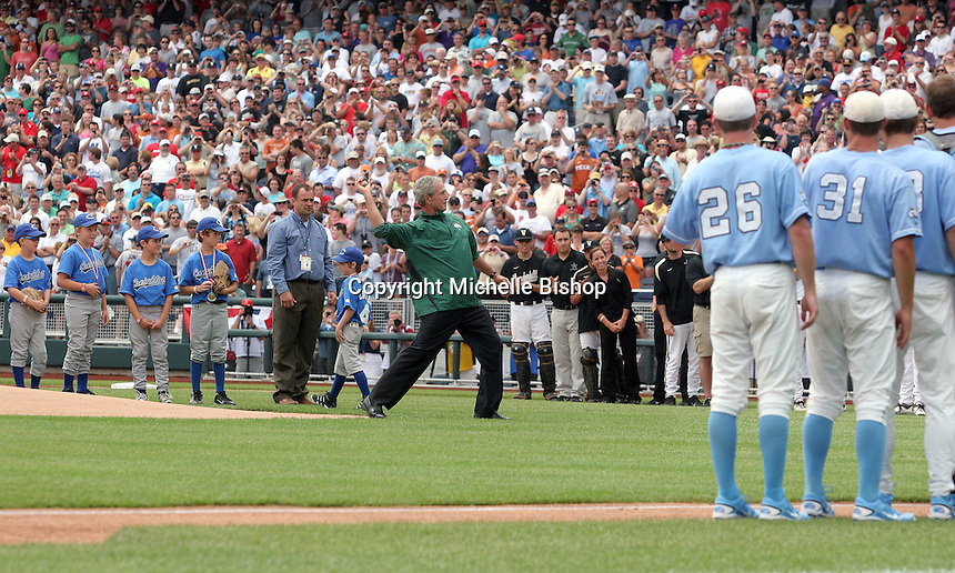 Former President George W. Bush throws out the ceremonial first pitch to open the 2011 College World Series. A crowd of 22,745 watched Vanderbilt beat UNC 7-3 in the first College World Series game played at TD Ameritrade Park Omaha. .
